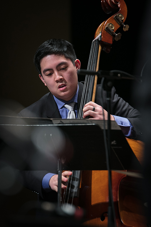 Bassist performing with a jazz ensemble at All-State Jazz Night