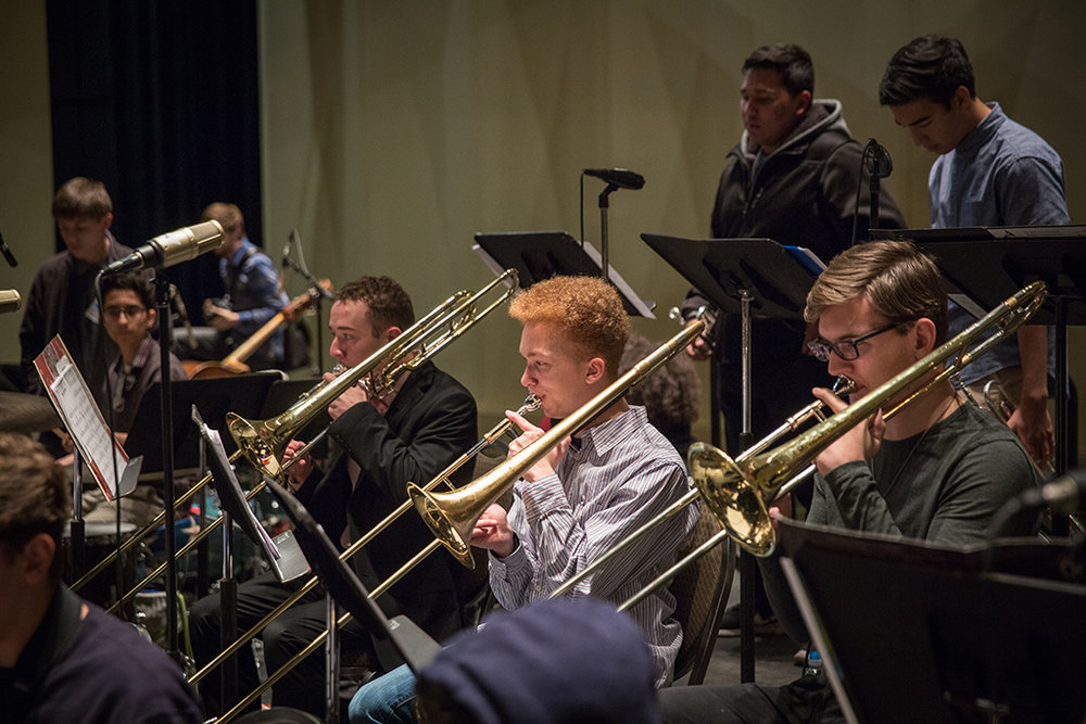 High School trombone students in rehearsal with an All-State Jazz Ensemble