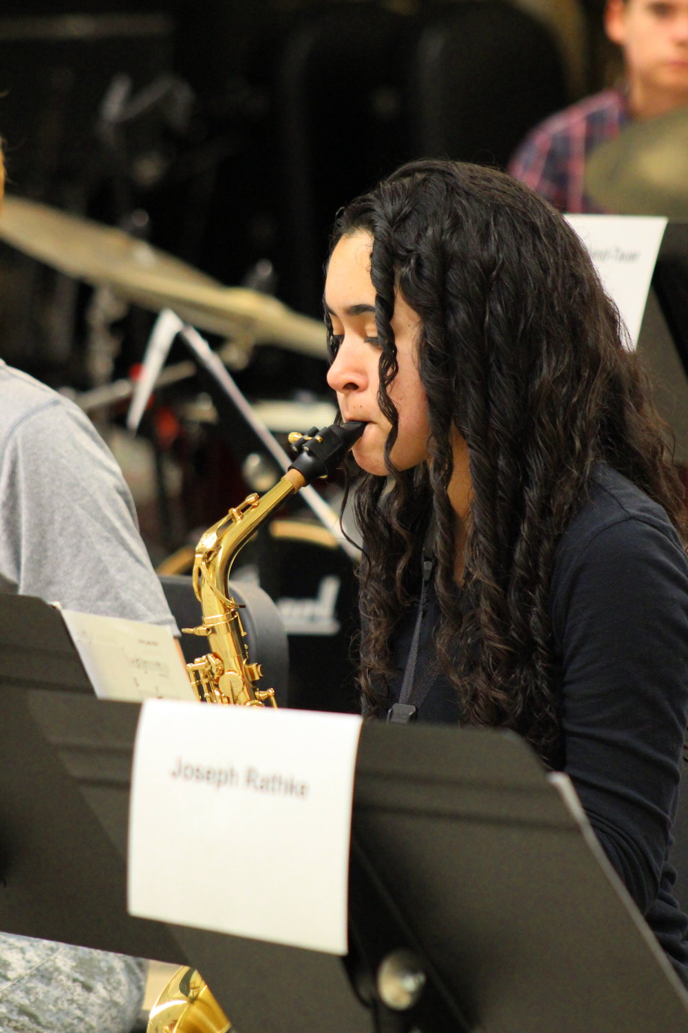 Female saxophone student in rehearsal at a district festival