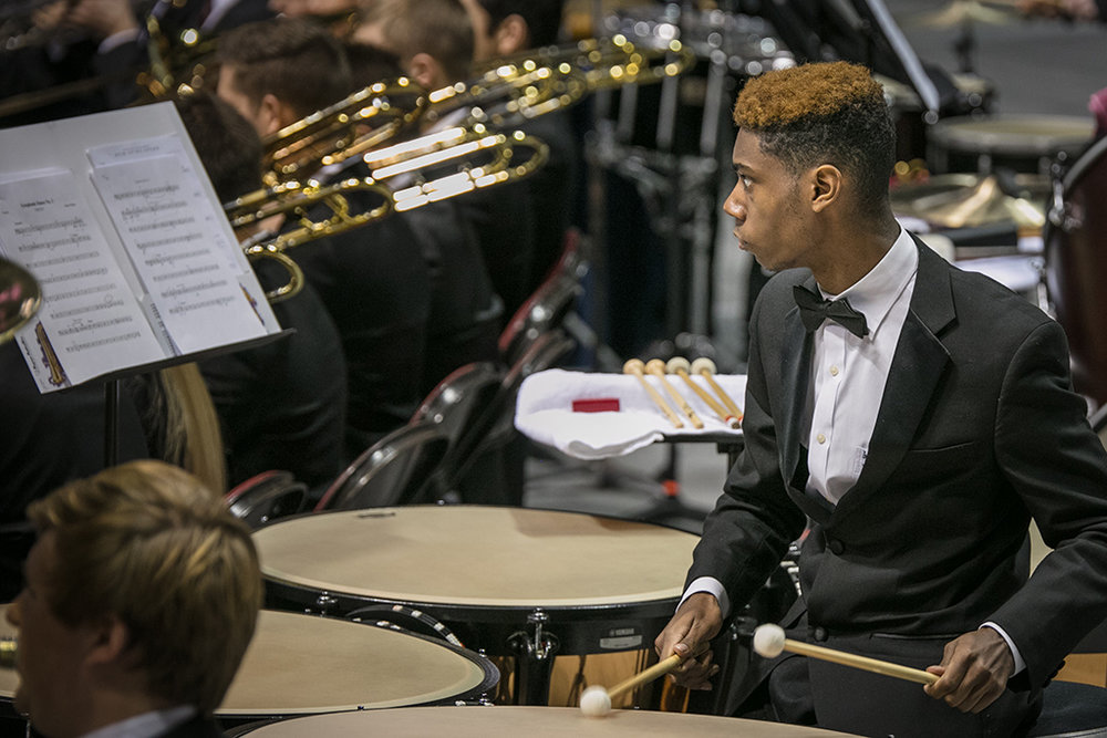 Student playing timpani at All-State concert