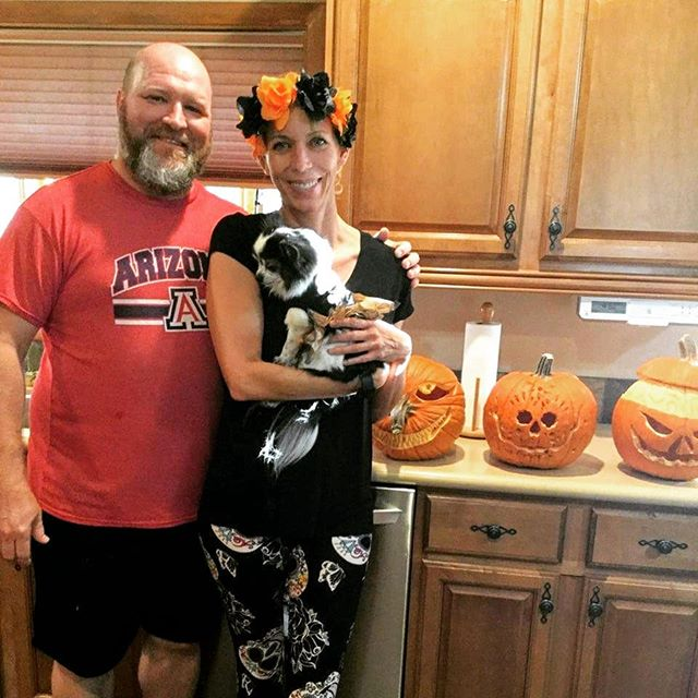 Happy Halloween! Jay hand-carved some beautiful pumpkins. And can you tell Jenny loves Dia de Los Muertos? Chloe doesn't love wearing a costume.