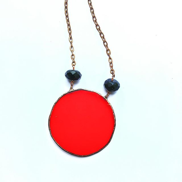 I've really fallen in love with this circle of red glass. Attached are blue goldstone. My girlfriend dubbed it the period piece for anyone wanting to celebrate their cycle because fuck the expectation of being ashamed about your time of the month. I'm a full grown woman who still unexpectedly bleeds through her high waisted polyester pants and I think that's beautiful ⚡️// $60 — DM to claim . . . . . . . #stainedglass #jewelry #glass #necklace #etsy #design #adornment #ootd #fashion #art #artist #maker #handmade #craftwithconscience