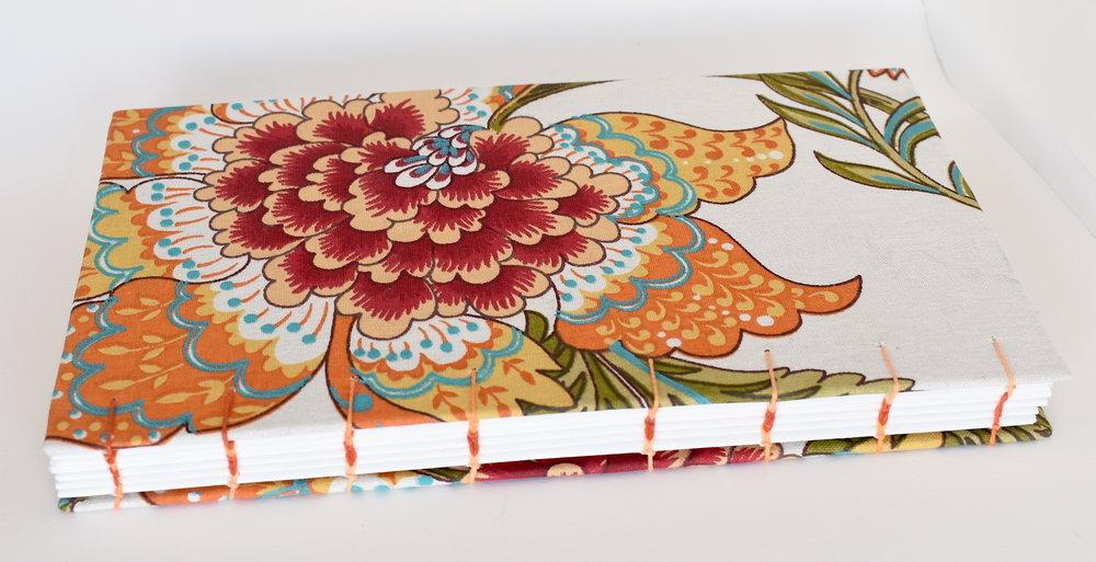 Orange floral binding.JPG