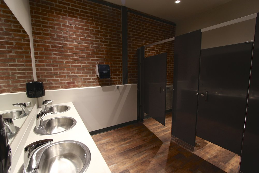 Metric Design, Saskatoon, Interior Design, Renovation, Office Washroom, Washroom Lighting, Exposed Brick, Washroom Stalls.jpg