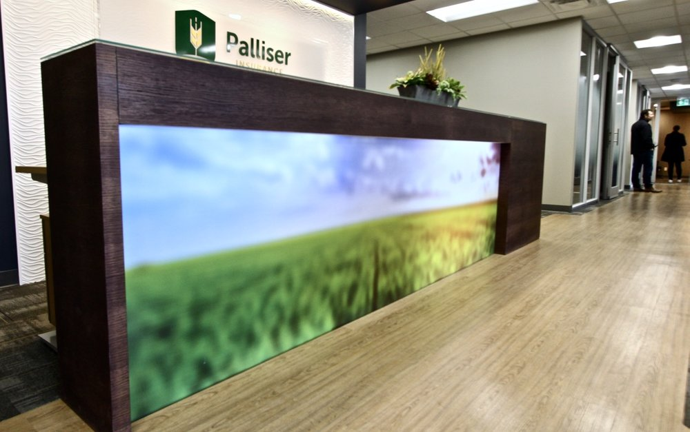 metric design centre, interior design, renovation, contractor, palliser insurance saskatoon, commercial, office, reception desk, large scale graphic printed.jpg