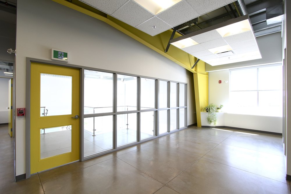 Metric Design, Interior Design, Saskatoon, Renovations, Yellow door, Entrance Bulkheads.jpg