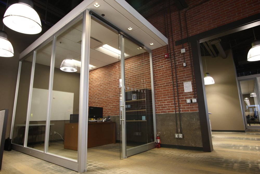 Metric Design, Saskatoon, Interior Design, Renovation, Office Partitions, Glass Partition, Exposed Brick, Pendant Lighting.jpg