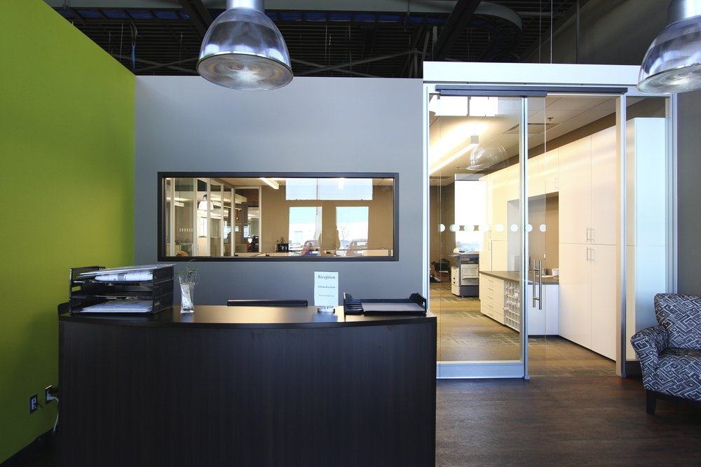 Metric Design, Interior Design, Renovation, Saskatoon, Reception Area, Green Wall, Office Seating.jpg