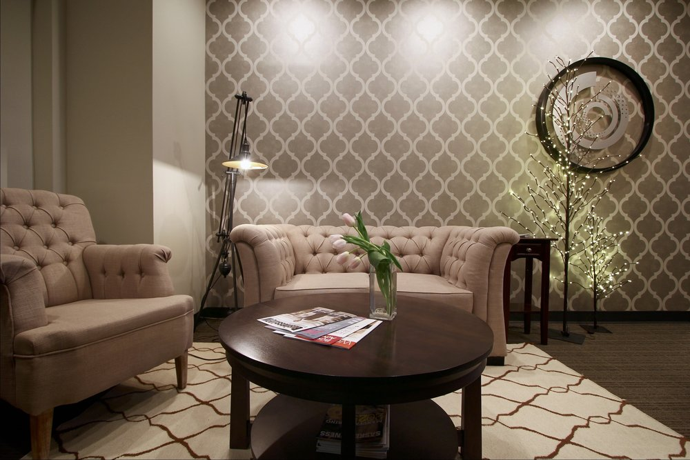 Metric Design Centre, Interior Design, Saskatoon, Commercial Design, Office, Quatrefoil Wallpaper, Rustic, Glam, Tufted Sofa, Round Coffeetable, Waiting Room, Rug, Front Entrance, Renovations, Contractor.jpg