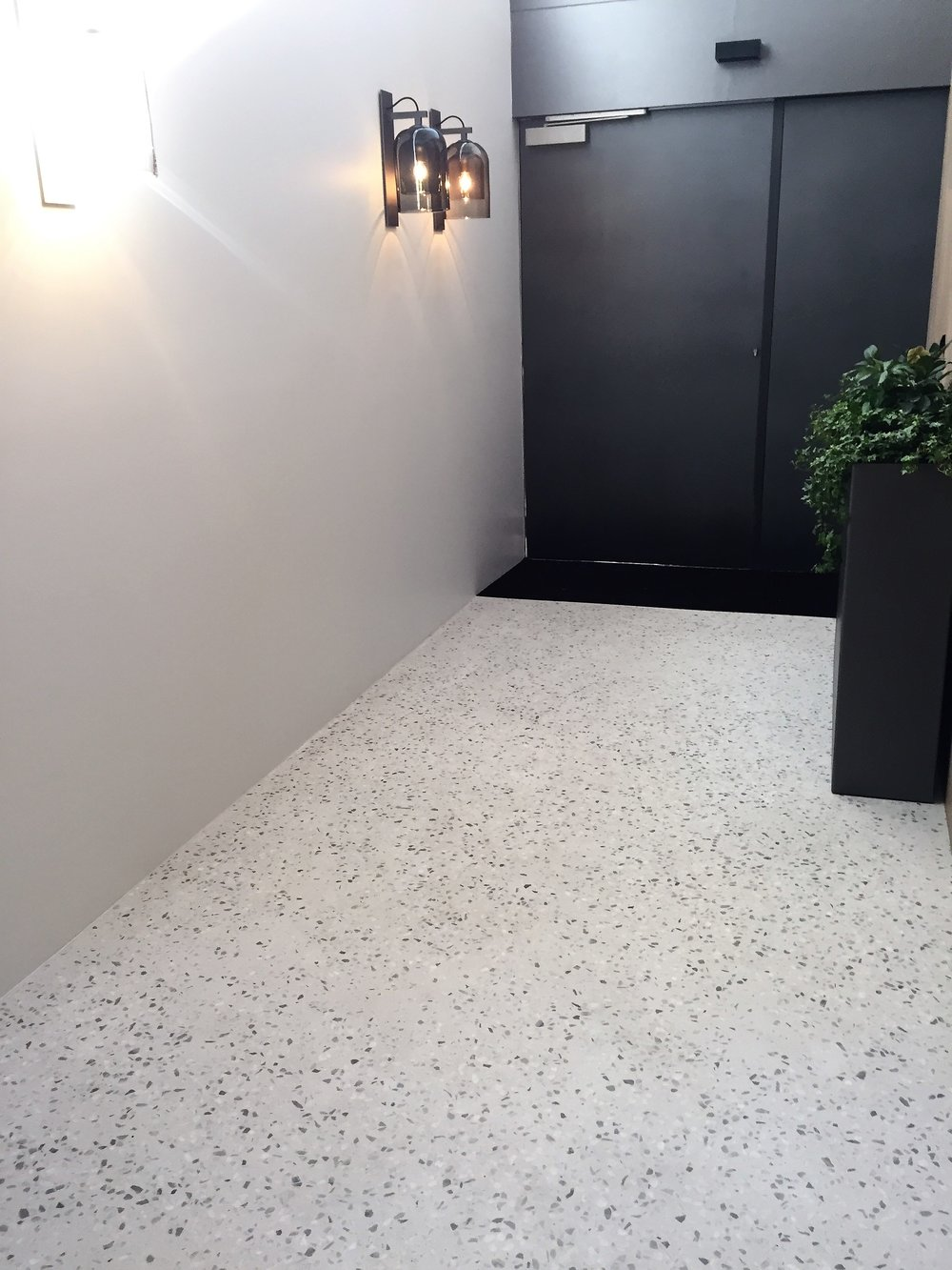 Covet concrete overlay shwroom.jpg