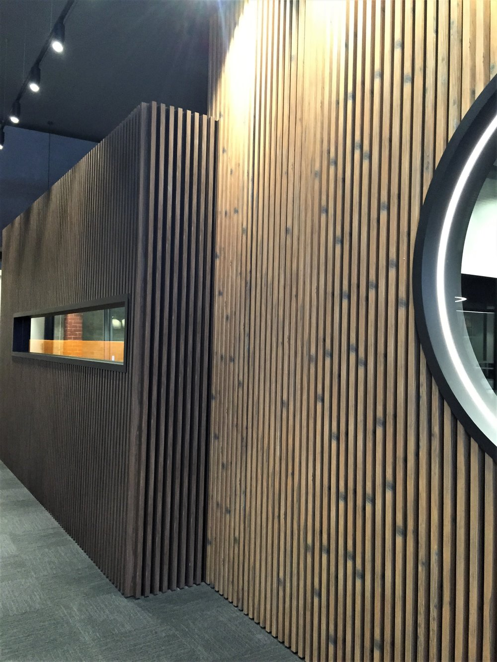 Boardroom Fitout - Richmond VIC Ever Art Wood® battens - Koshi 30x50mm standard hollow section in Nacyuraru (foreground) & Buraun Eboni (background)
