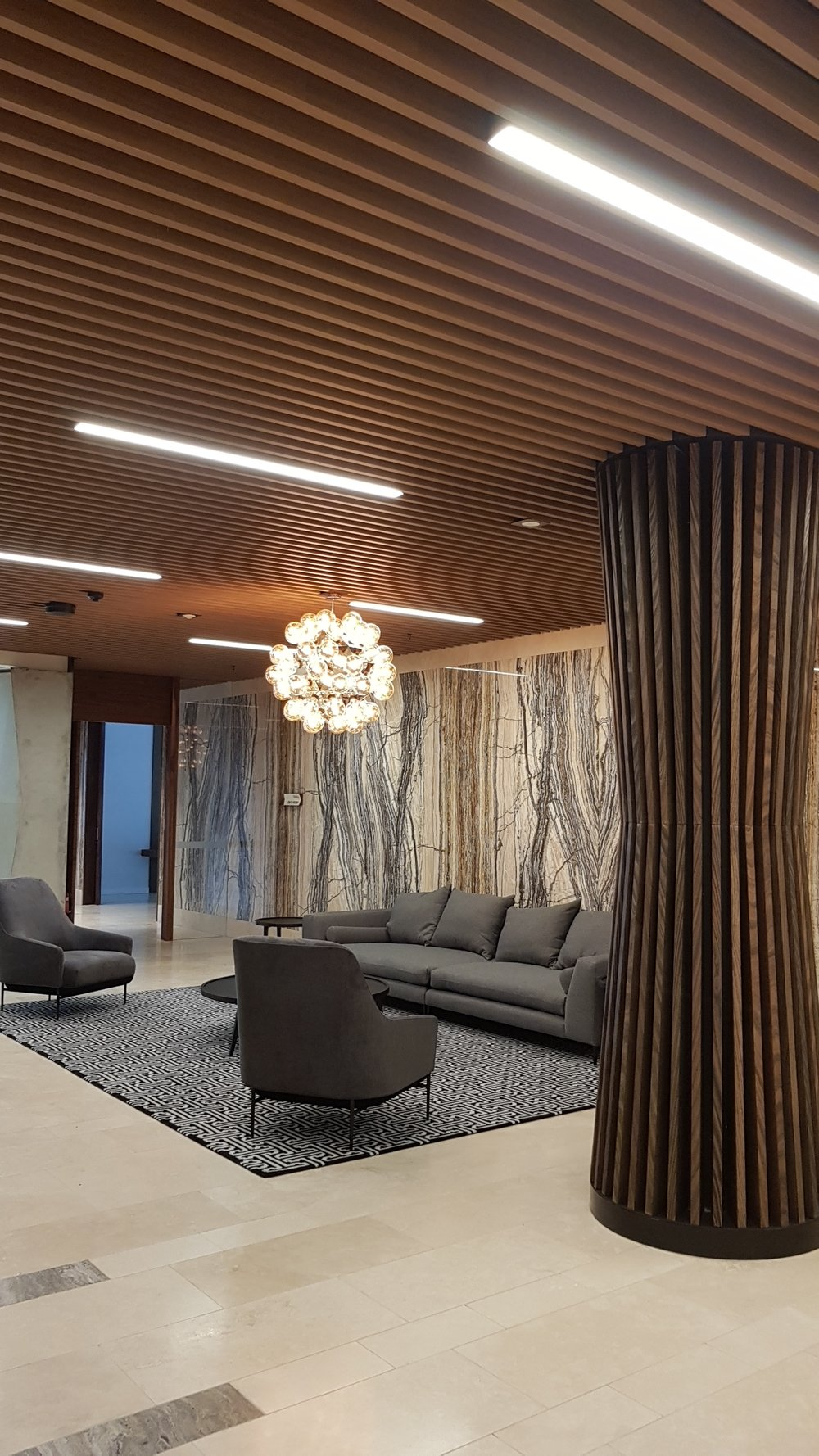 Lakeside Apartments Lobby - Melbourne VIC Ever Art Wood® Kabebari-T Suspended Ceiling System - Kabebari 30x85 battens in Kuri Masame; Custom powdercoated T section in Black
