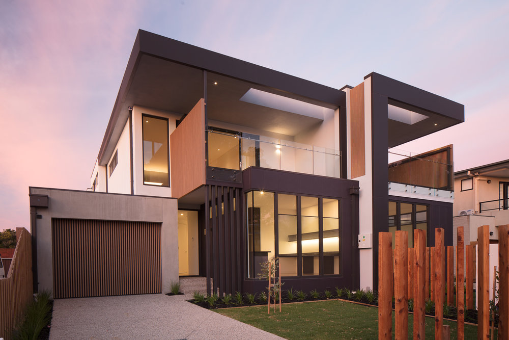Dual townhouse development - Seaholme VIC Ever Art Wood® battens - Kabebari 30x50 to garage doors; Doubuchi prefabricated screen cladding.