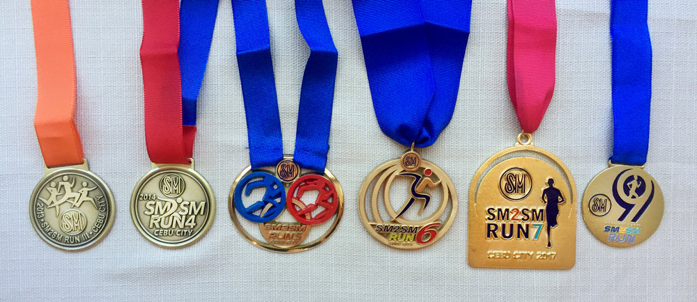 Medals from the past SM2SM Runs with its latest, Year 9.