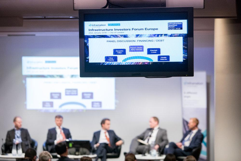 Auditorium shot depicting panel members
