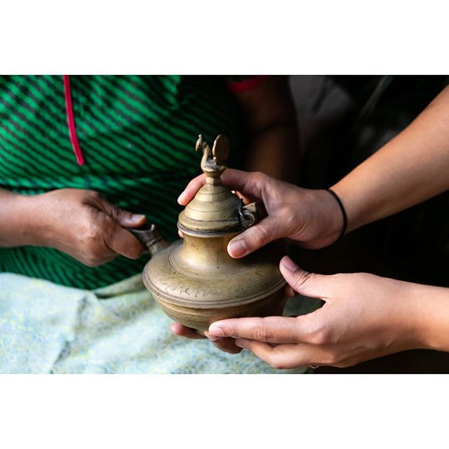 Alpana: This is a very precious item. You would have your name engraved on it. • Damyantiben: This is my dad's name. This pot is for clarified butter - ghee. When the son-in-law or the daughter-in-law come to the family home for the first time, the mother pours the ghee over the food. • A: It's a special serving utensil for that first visit after the wedding. • D: I lived with my mom for 2 years in Khambhat after I got married because my husband was away studying in America. But most girls wouldn't live with their husbands right away anyway. After some time, on an auspicious day, the husband's family would ask for the young wife to come back with them. That's the way it was. They'd get married at 15 or 16, and they didn't know what married life was like. Now it's different. • #justincase #justincaseproject #photoessay #photoseries #photojournalism #documentaryphotography #immigration #immigrants #immigrationstories #interview #india #gujarat #Khambhat #inheritance #ghee #indianimmigrants #tradition #motherdaughter #inlaws #gheejar #preciousitems