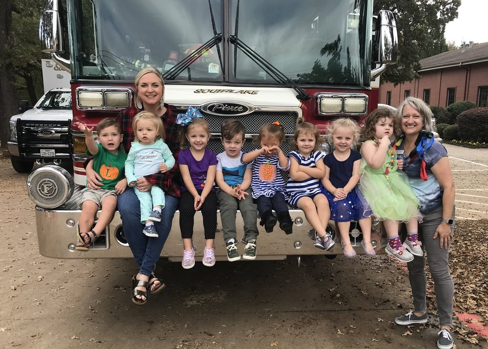 Thank you, Southlake DPS, for visiting us! - The Southlake Fire Department came out to visit us, letting the children see their firefighting gear and sit in the fire truck. They were a big hit, but the children were a big hit with them, as well, showing off their Stop, Drop & Roll skills!