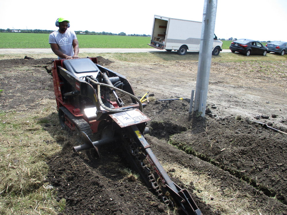 Steffon drives the trencher.