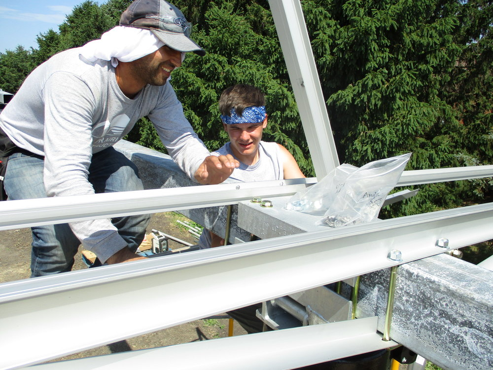 Waheed and Quinn assemble the module rails.