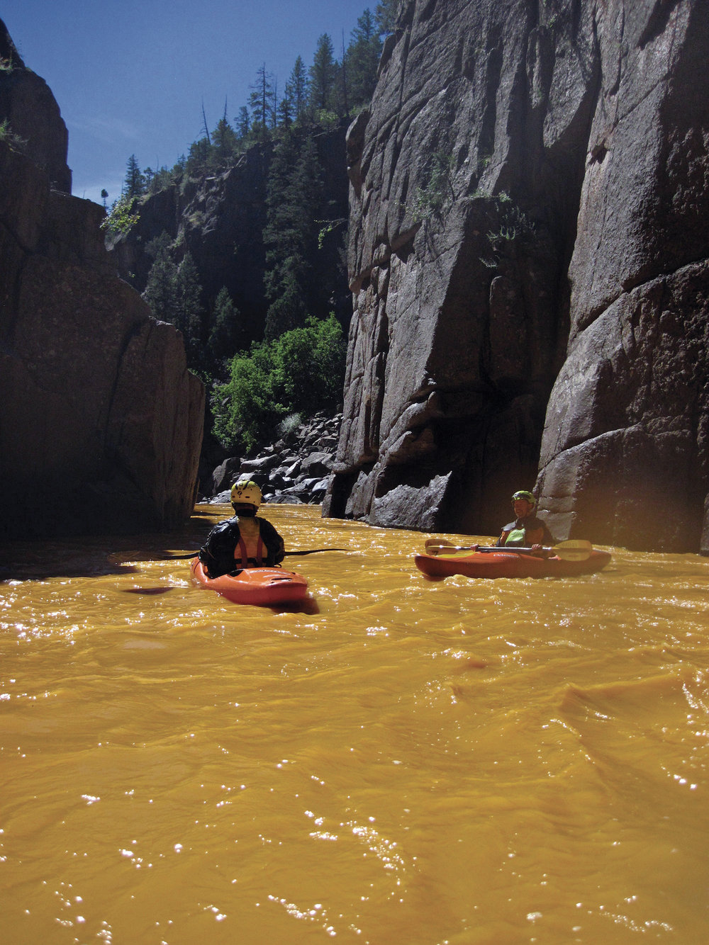 Eric Parker and Dave Farkas float on the Animas River post Gold King Mine spill.  Photo by Dan Steaves.