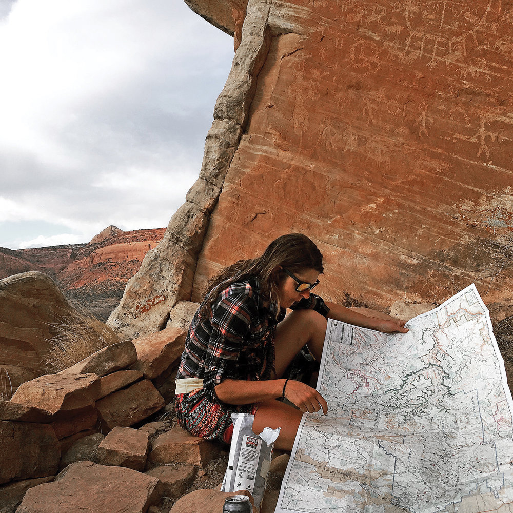 Carruth plans her route through Dark Canyon. Photo by Sarah Tescher