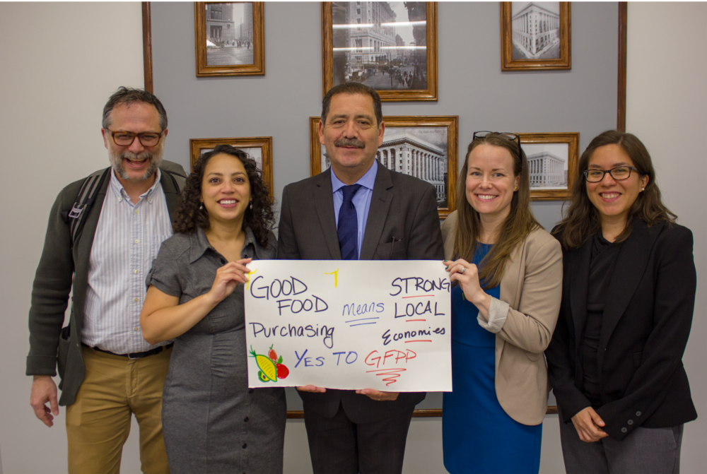 "Rodger Cooley, Lilian Jimenez, Cook County Commissioner Jesús ""Chuy"" García, Christina Bronsing-Lazalde, and Victoria Moreno celebrate the passage of the Good Food Purchasing Resolution by the Cook County Board of Commissioners"