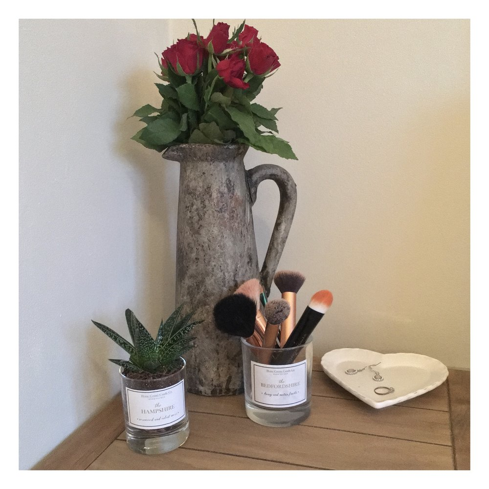 how to reuse your home county candle co. glass - Want to know how to recycle candles? Whilst our glass containers are recyclable, we think they're also too pretty to be thrown straight in the recycling bin, so why not think of some creative ways to reuse them once the beautifully scented wax is all gone (sob!)?1. When you're all finished with your candle we'd recommend popping the glass in the oven at around 180 degrees for 10 minutes or so – just long enough to melt the leftover wax at the bottom of the glass.2. Pour the melted wax into the bin (there won't be much – don't worry, we hate waste too!) and boil the kettle.3. Ensuring you've got a metal spoon in the glass to stop it cracking, pour some boiling water into the glass to clean away any remaining wax (avoid too much water or you'll spoil the pretty label!)4. Now you've got a pretty glass container to use for your bits and bobs! I use mine for my makeup brushes – but please do feel free to send us your pictures of creative ways you're reusing your Home County Candle Co. glasses!