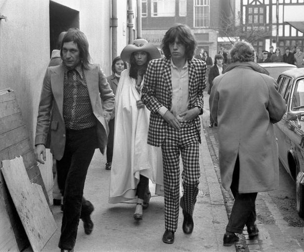 Charlie Watts, Mick Jagger and his girlfriend Bianca De Macias arrive at Coventry Theatre 6th March 1971.jpeg