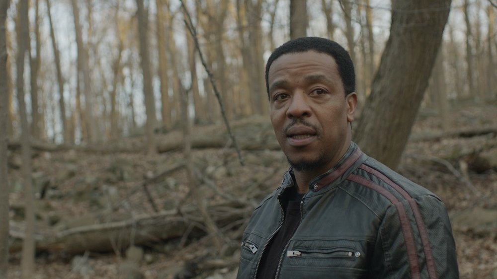 Fevah Stills - Jelani (Russell Hornsby) watches from the forest1.jpg