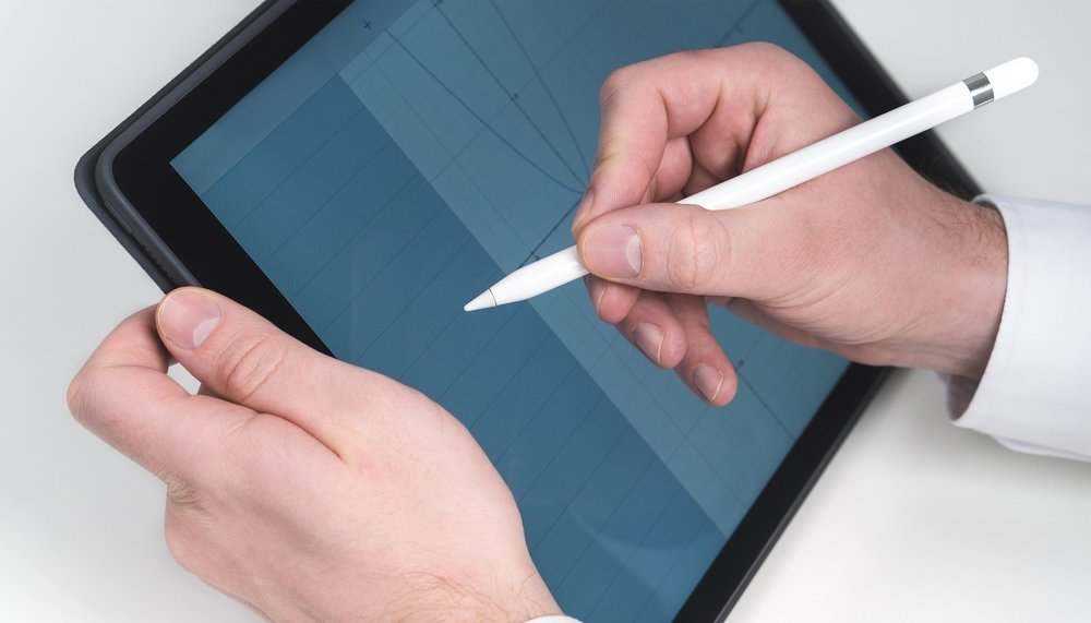 Stock photo of a man with an iPad. Go with it.