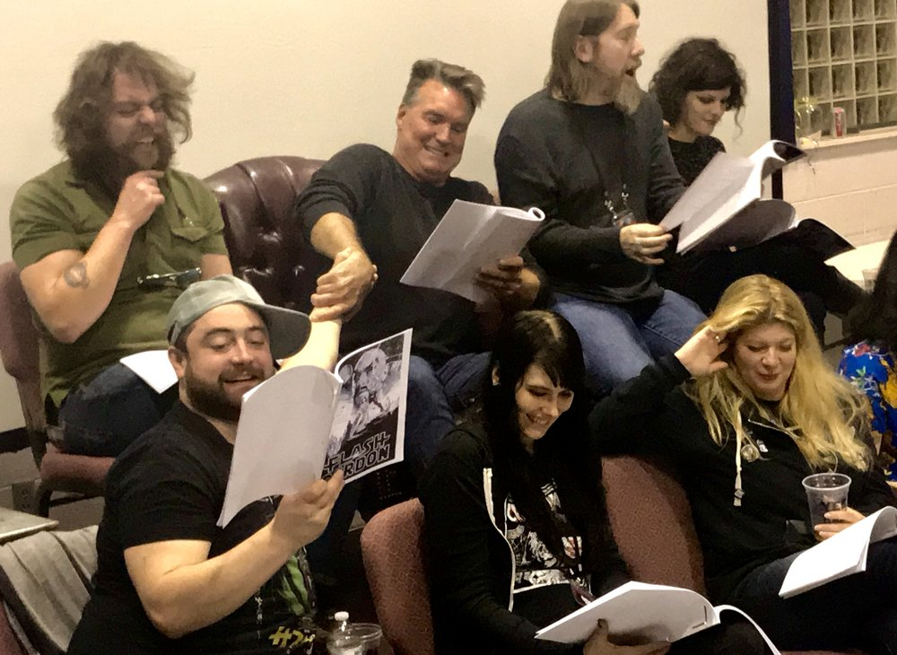 """Flash Gordon"" actor Sam Jones (center) leads a table read of that film's script. (Photo: Bex Feldbin)"