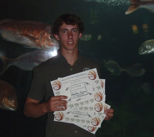 Harrison Warne with his fistful of winner's certificates from the 2013 Atlas photo comp