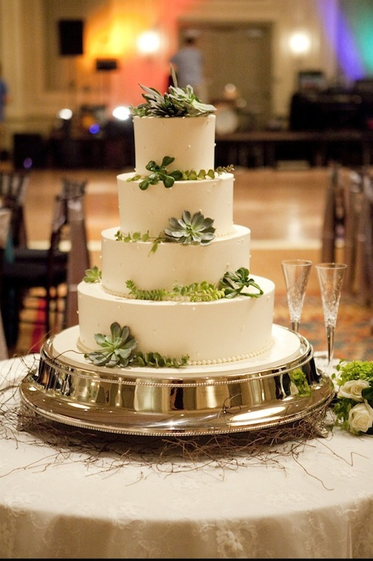 wedding - 4 tier cake with decorative leaves and flowers.jpg