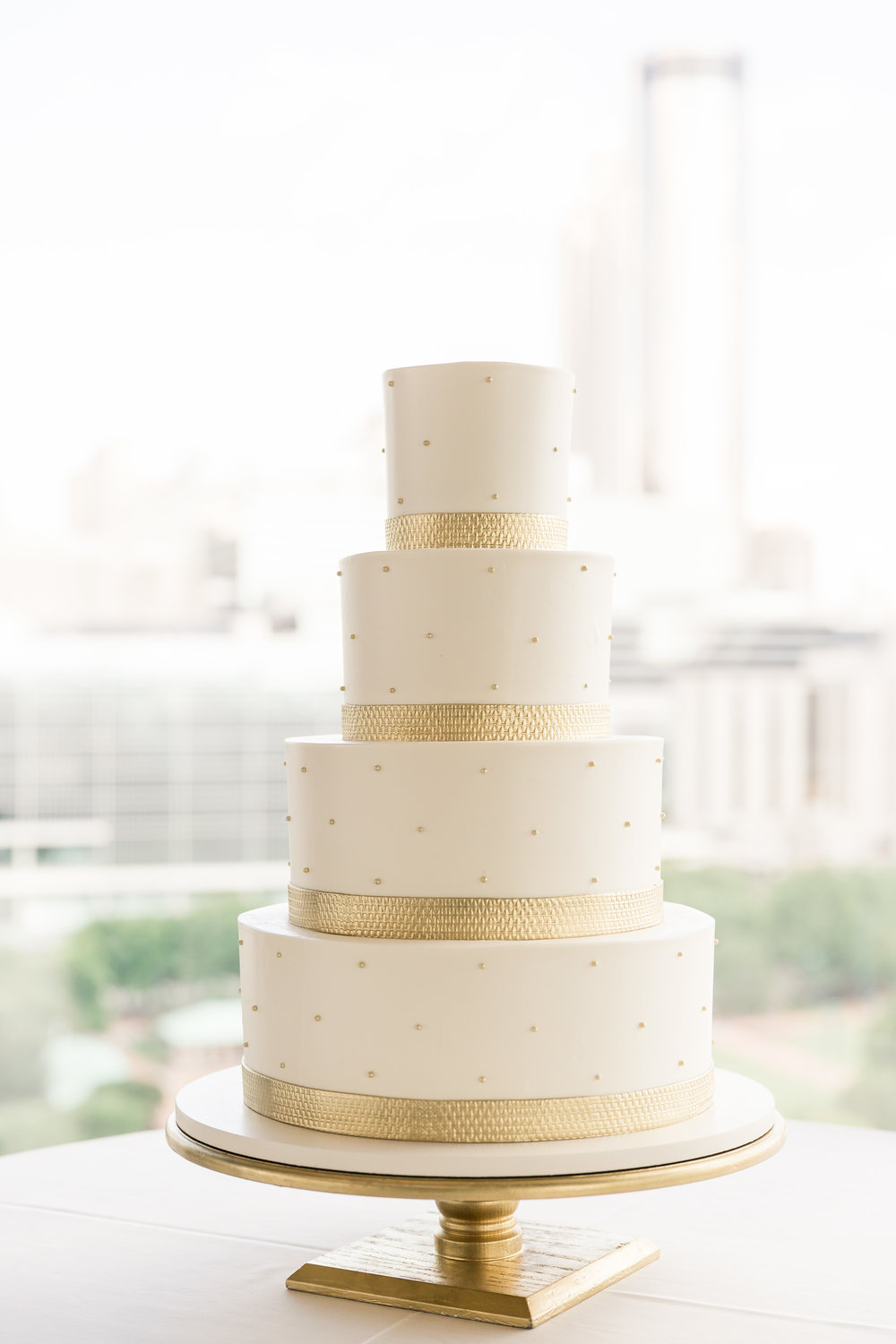 signature - Gold textured ribbon wedding cake.jpg