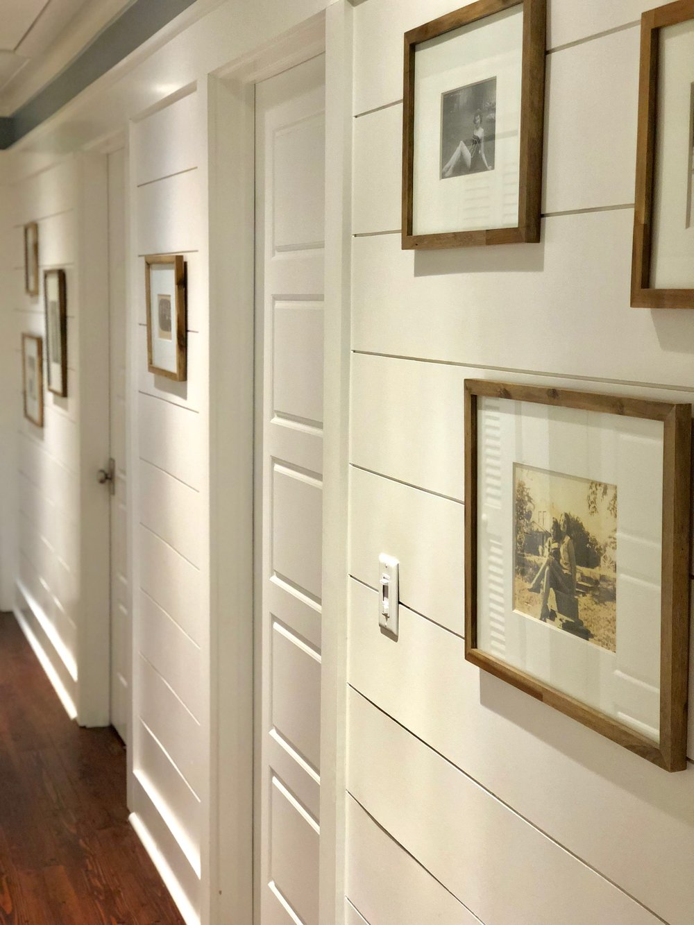"""I love black and white photos! The hallway leading to our master is filled with old photos of our great grandparents and grandparents -- we call it the """"Ancestor Hallway.""""    I think it's super important to remember where YOU came from, and we both have lots of cool family history. I'm obsessed with the vintage wedding photos specifically -- I love looking back at how fashions have changed. My grandparents have been a tremendous force in my life, so it's important to me that my girls and I look at these photos everyday."""