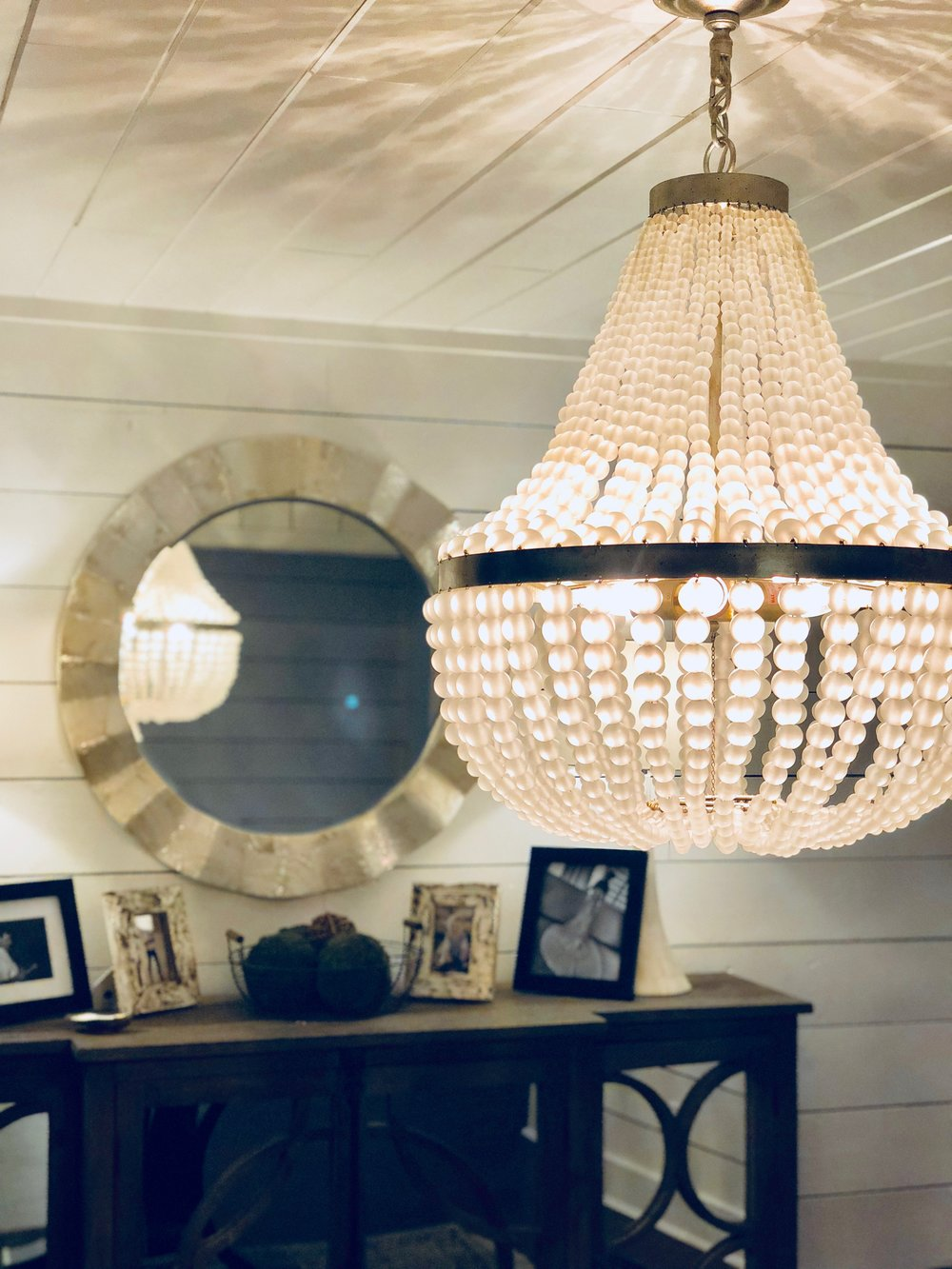 """Last summer my friend Kelly Caron, an awesome local designer, helped me re-imagine our dining room. We chose this chandelier for the center of the room and I can honestly say it's the most """"adult"""" thing I've ever bought. Brian was hysterically laughing because I told him I finally felt like an adult after installing the thing. He was like, """"I mean...married with kids is pretty adult"""". Ha!It's the perfect amount of fancy and I feel blessed to have it."""