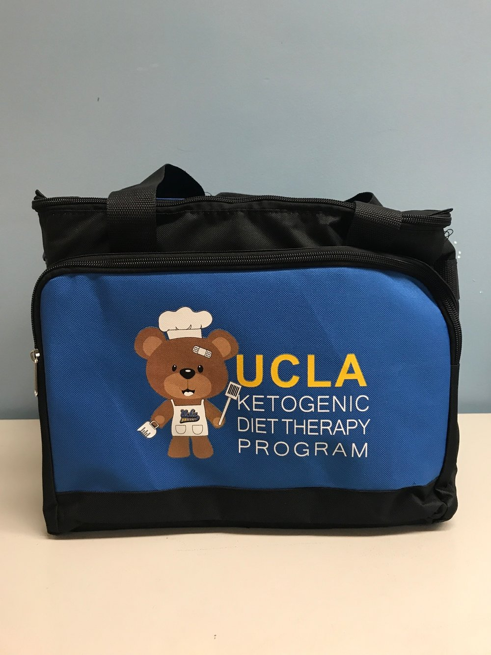 An example of a Ketogenic Basket.  Money raised is donated to UCLA to purchase these baskets for incoming Ketogenic Diet pediatric patients.  To help parents with this overwhelming diet we try to provide a little financial assistance with purchasing some of these items for them.  Some of the items that can be found in this cooler are a measuring scale, toothpaste, Tupperware, teas, candy molds, spatulas, and dry food items.  The total cost for one basket is $225.