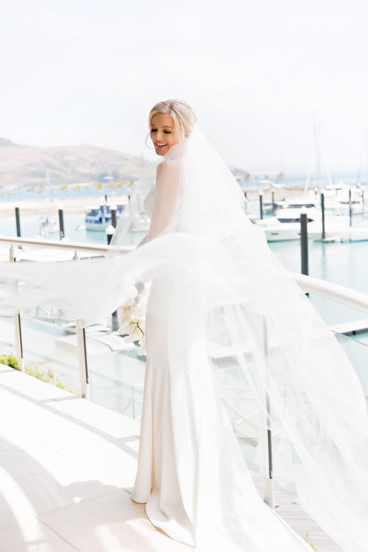 wedding-0119-bride-veil-wind-beautiful-boats-queensland.jpg