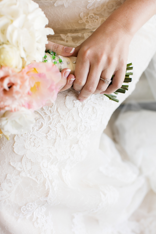 wedding-0319-rings-flowers-lace-dress-brisbane.jpg