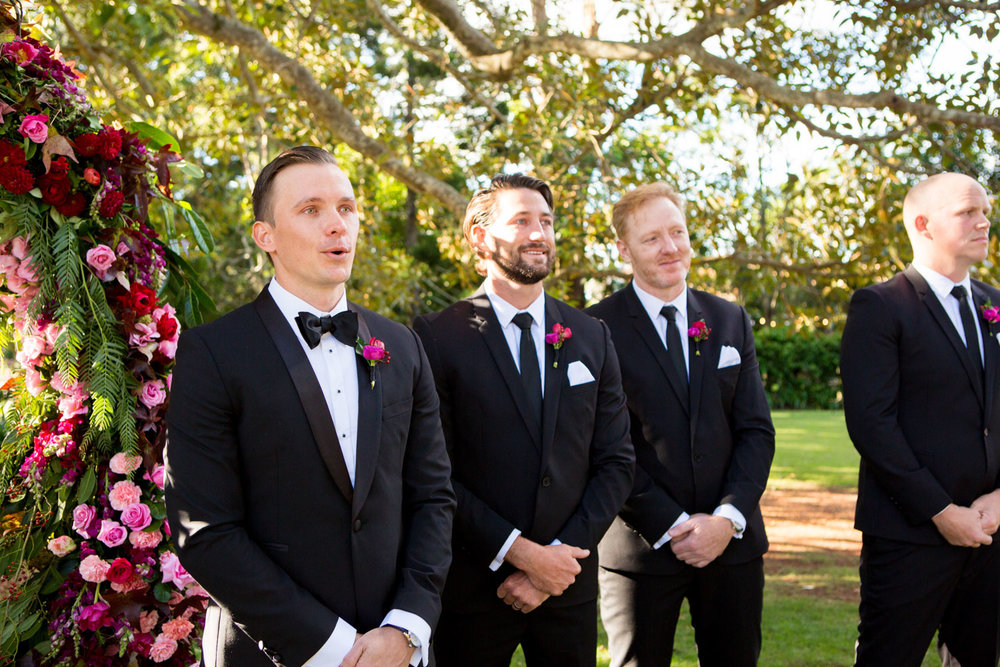 wedding-0045-groom-ceremony-flowers-garden-tears-australia.jpg