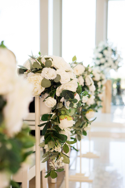 wedding-0194-ceremony-aisle-flowers-chapel-white-queensland.jpg