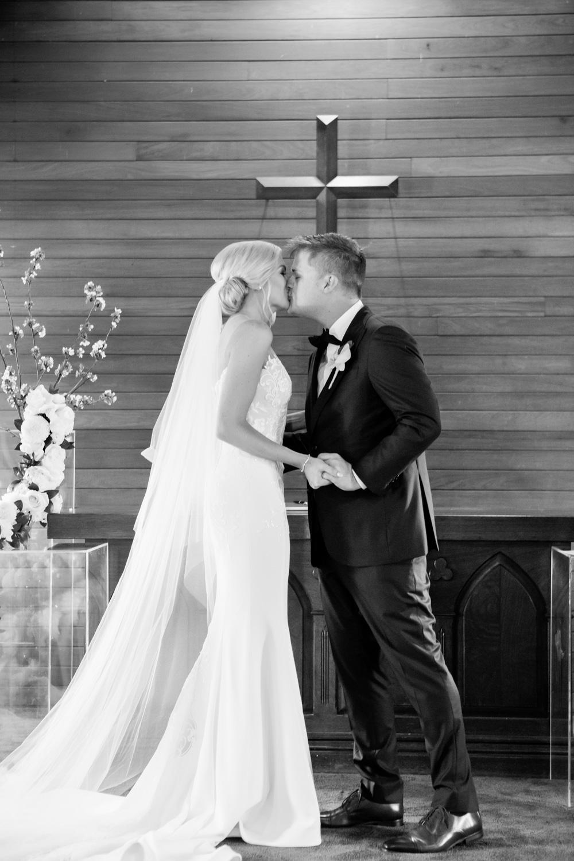 wedding-0126-chapel-kiss-excitement-official-veil-australia.jpg