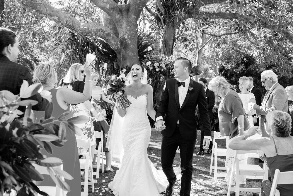 wedding-0052-ceremony-flowers-garden-arch-excited-brisbane.jpg