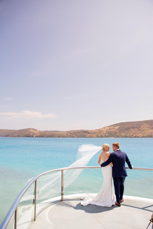 wedding-0131-yachtclub-veil-wind-happy-ocean-queensland.jpg