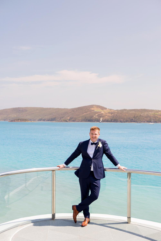 wedding-0134-mantaray-groom-bowtie-blue-excited-queensland.jpg
