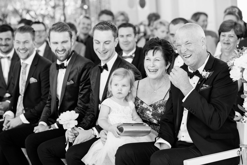 wedding-0203-ceremony-laughing-guests-happy-aisle-queensland.jpg