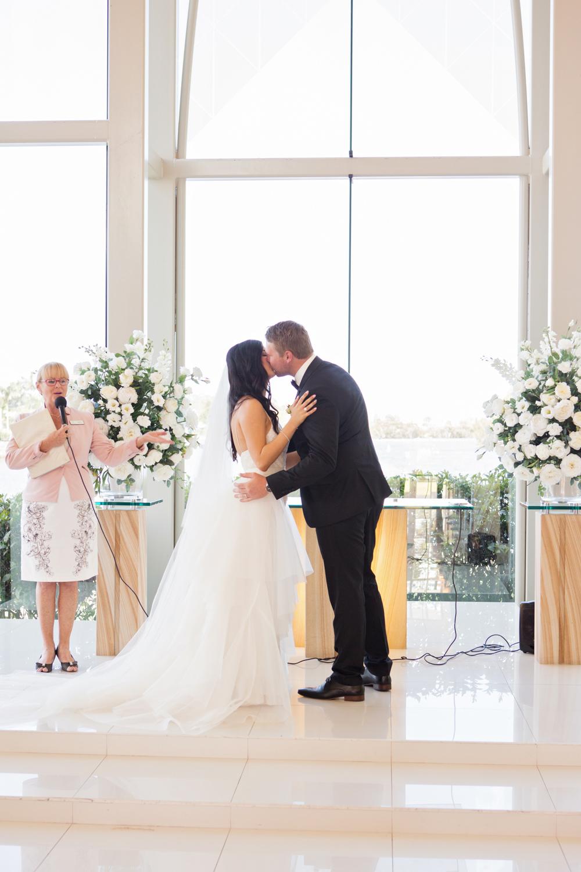 wedding-0206-ceremony-chapel-kiss-glass-bright-queensland.jpg
