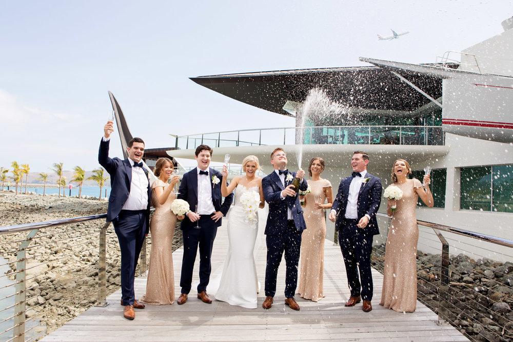 wedding-0140-yachtclub-champagne-pop-spray-toast-queensland.jpg