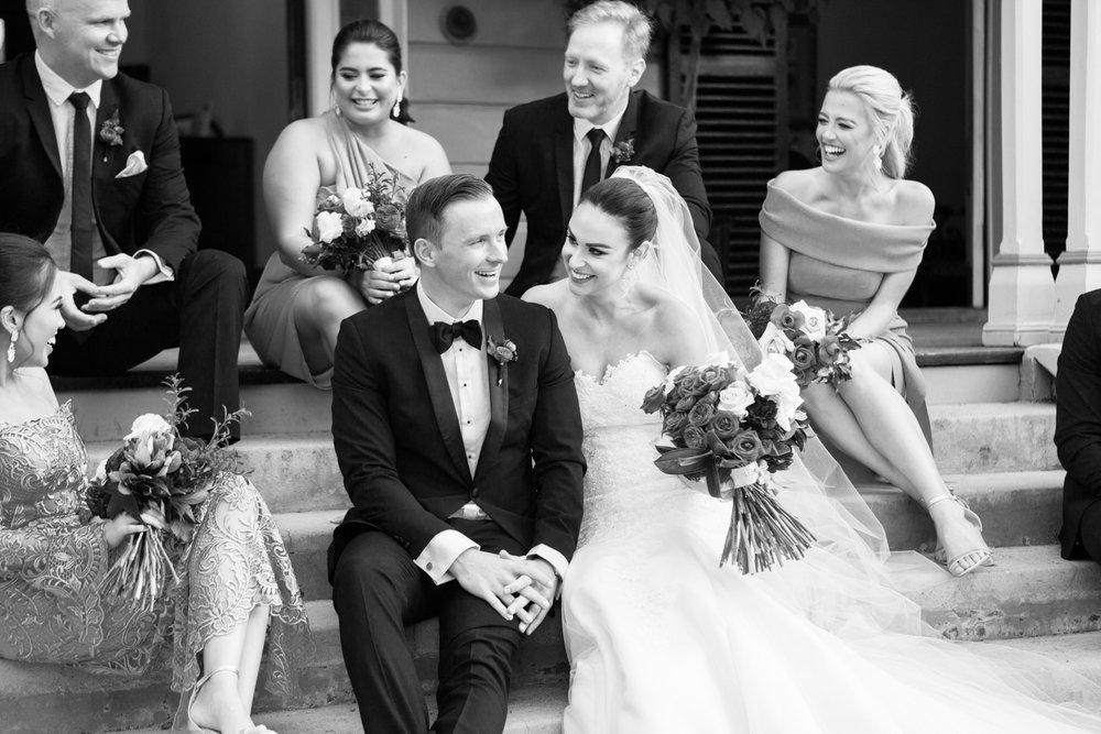 wedding-0063-bridalparty-laughter-joy-sitting-bowtie-australia.jpg