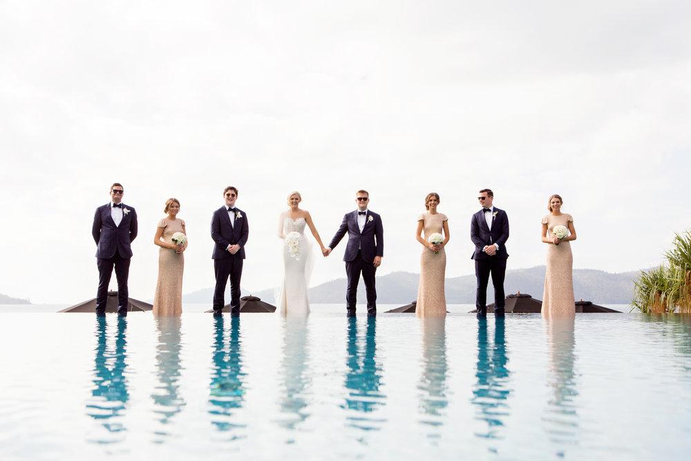 wedding-0142-qualia-pool-bridalparty-reflections-brisbane.jpg
